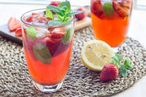 Two glasses of strawberry iced tea