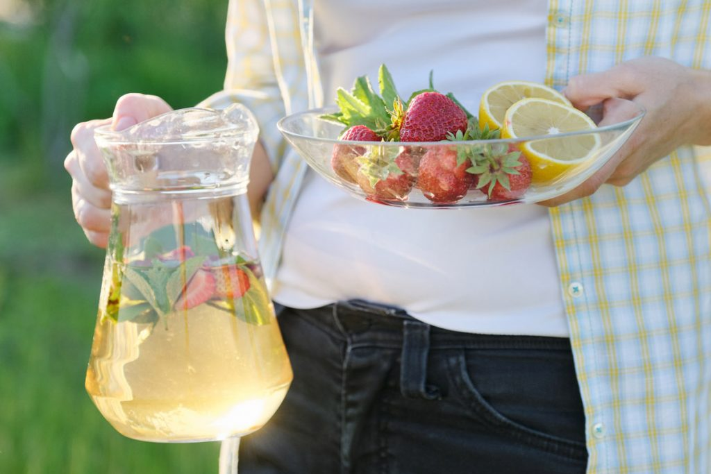 person carrying strawberry lemonade