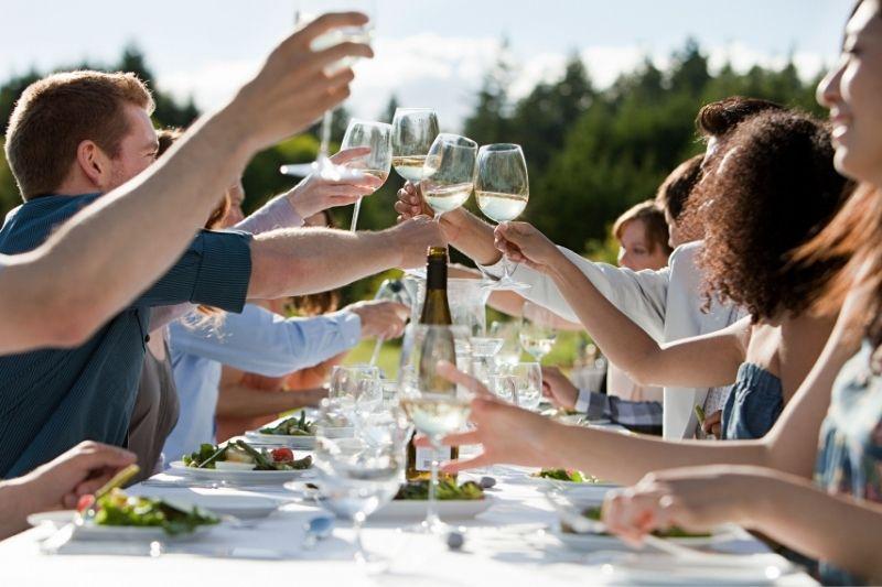Supper Club friends toast
