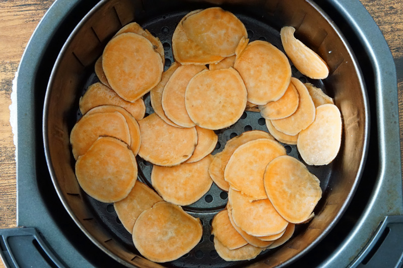 Raw Sweet Potato Chips in the Air Fryer Basket